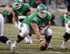 Nov 23, 2013; Denton, TX, USA; North Texas Mean Green offensive linesman Kaydon Kirby (50) prepares to snap the ball during the game against the UTSA Roadrunners at Apogee Stadium. The Roadrunners defeated the Mean Green 21-13. Mandatory Credit: Jerome Miron-USA TODAY Sports