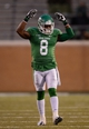 Nov 23, 2013; Denton, TX, USA; North Texas Mean Green defensive back Marcus Trice (8) fires up the crowd during the game against the UTSA Roadrunners at Apogee Stadium. The Roadrunners defeated the Mean Green 21-13. Mandatory Credit: Jerome Miron-USA TODAY Sports