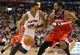 Nov 22, 2013; Toronto, Ontario, CAN; Toronto Raptors guard DeMar DeRozan (10) tries to get past Washington Wizards forward Nene (42) at Air Canada Centre. The Raptors beat the Wizards 96-88. Mandatory Credit: Tom Szczerbowski-USA TODAY Sports
