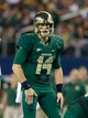 Nov 16, 2013; Arlington, TX, USA; Baylor Bears quarterback Bryce Petty (14) in the backfield during the game against the Texas Tech Red Raidersat AT&T Stadium. Baylor beat Texas Tech 63-34. Mandatory Credit: Tim Heitman-USA TODAY Sports