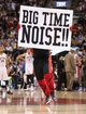 Nov 22, 2013; Toronto, Ontario, CAN; Toronto Raptors mascot holds up a sign pleading for more noise against the Washington Wizards at Air Canada Centre. The Raptors beat the Wizards 96-88. Mandatory Credit: Tom Szczerbowski-USA TODAY Sports