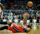 Nov 27, 2013; Milwaukee, WI, USA;  Washington Wizards forward Nene Hilario (42) passes the ball while laying on his back during the game against the Milwaukee Bucks in the first quarter at BMO Harris Bradley Center. Mandatory Credit: Benny Sieu-USA TODAY Sports