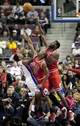 Nov 27, 2013; Auburn Hills, MI, USA; Detroit Pistons point guard Brandon Jennings (7) makes a jump shot over Chicago Bulls point guard Marquis Teague (25) and center Nazr Mohammed (48) during the second quarter at The Palace of Auburn Hills. Mandatory Credit: Raj Mehta-USA TODAY Sports