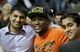 Nov 27, 2013; Auburn Hills, MI, USA; American professional boxer Floyd Mayweather Jr. poses with Detroit Pistons fans for a photo during halftime against the Chicago Bulls at The Palace of Auburn Hills. Mandatory Credit: Raj Mehta-USA TODAY Sports