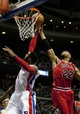 Nov 27, 2013; Auburn Hills, MI, USA; Detroit Pistons center Andre Drummond (0) gets his shot blocked by Chicago Bulls power forward Taj Gibson (22) during the third quarter at The Palace of Auburn Hills. Bulls beat the Pistons 99-79. Mandatory Credit: Raj Mehta-USA TODAY Sports