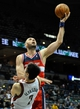 Nov 27, 2013; Milwaukee, WI, USA;  Washington Wizards center Marcin Gortat (4) makes a basket against Milwaukee Bucks forward Ersan Ilyasova (7) in overtime at BMO Harris Bradley Center. The Wizards beat the Bucks 100-92 in overtime. Mandatory Credit: Benny Sieu-USA TODAY Sports