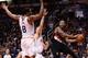 Nov 27, 2013; Phoenix, AZ, USA; Portland Trail Blazers guard Damian Lillard (0) passes the ball around Phoenix Suns forward Channing Frye (8) in the first half at US Airways Center. The Suns won 120-106.  Mandatory Credit: Jennifer Stewart-USA TODAY Sports