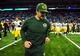 Nov 28, 2013; Detroit, MI, USA; Green Bay Packers quarterback Aaron Rodgers (12) runs off the field after losing to the Detroit Lions 40-10 during a NFL football game on Thanksgiving at Ford Field. Mandatory Credit: Andrew Weber-USA TODAY Sports