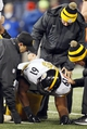 Nov 28, 2013; Baltimore, MD, USA; Pittsburgh Steelers center Fernando Velasco (61) is attended to by team medical staff after suffering an injury against the Baltimore Ravens during a NFL football game on Thanksgiving at M&T Bank Stadium. Mandatory Credit: Mitch Stringer-USA TODAY Sports