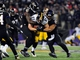 Nov 28, 2013; Baltimore, MD, USA; Pittsburgh Steelers tight end Heath Miller (83) gets tackled by Baltimore Ravens safety James Ihedigbo (32) and linebacker Daryl Smith (51) during a NFL football game on Thanksgiving at M&T Bank Stadium. Mandatory Credit: Evan Habeeb-USA TODAY Sports