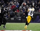 Nov 28, 2013; Baltimore, MD, USA; Pittsburgh Steelers wide receiver Antonio Brown (84) catches a pass against the Baltimore Ravens during a NFL football game on Thanksgiving at M&T Bank Stadium. Mandatory Credit: Evan Habeeb-USA TODAY Sports