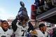 Nov 29, 2013; Lincoln, NE, USA; Iowa Hawkeyes defensive lineman Carl Davis (71) carries the Heroes Game trophy after defeating the Nebraska Cornhuskers at Memorial Stadium. Iowa won 38-17. Mandatory Credit: Bruce Thorson-USA TODAY Sports