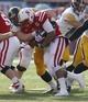 Nov 29, 2013; Lincoln, NE, USA; Iowa Hawkeyes defender Drew Ott (95) sacks Nebraska Cornhuskers quarterback Ron Kellogg III (12) in the third quarter at Memorial Stadium. Iowa won 38-17. Mandatory Credit: Bruce Thorson-USA TODAY Sports