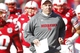 Nov 29, 2013; Lincoln, NE, USA; Nebraska Cornhuskers head coach Bo Pelini leads his team onto the field prior to the game against the Iowa Hawkeyes at Memorial Stadium. Iowa won 38-17. Mandatory Credit: Bruce Thorson-USA TODAY Sports