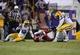 Nov 29, 2013; Baton Rouge, LA, USA; Arkansas Razorbacks quarterback Brandon Allen (10) fumbles the ball between LSU Tigers defensive end Jermauria Rasco (59) and cornerback Dwayne Thomas (13) in the fourth quarter at Tiger Stadium. LSU defeated Arkansas 31-27. Mandatory Credit: Crystal LoGiudice-USA TODAY Sports