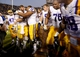 Nov 29, 2013; Baton Rouge, LA, USA; LSU Tigers offensive tackle La'el Collins (70) hugs quarterback Zach Mettenberger (8) as he stands with the help of crutches beside teammates as they celebrate defeating the Arkansas Razorbacks 31-27 at Tiger Stadium. Mandatory Credit: Crystal LoGiudice-USA TODAY Sports