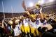 Nov 29, 2013; Baton Rouge, LA, USA; LSU Tigers offensive tackle La'el Collins (70) and teammates lift up the boot after defeating the Razorbacks at Tiger Stadium. LSU defeated Arkansas 31-27. Mandatory Credit: Crystal LoGiudice-USA TODAY Sports