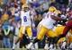 Nov 29, 2013; Baton Rouge, LA, USA; LSU Tigers quarterback Zach Mettenberger (8) passes the ball against the Arkansas Razorbacks in the second half at Tiger Stadium. LSU defeated Arkansas 31-27. Mandatory Credit: Crystal LoGiudice-USA TODAY Sports