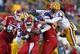 Nov 29, 2013; Baton Rouge, LA, USA; LSU Tigers safety Craig Loston (6) jumps onto the pile as Arkansas Razorbacks running back Alex Collins (3) is tackled from behind by LSU Tigers defensive end Jermauria Rasco (behind) at Tiger Stadium. LSU defeated Arkansas 31-27. Mandatory Credit: Crystal LoGiudice-USA TODAY Sports