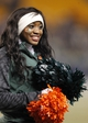 Nov 29, 2013; Pittsburgh, PA, USA; Miami Hurricanes cheerleader performs against the Pittsburgh Panthers during the third quarter at Heinz Field. Miami won 41-31. Mandatory Credit: Charles LeClaire-USA TODAY Sports