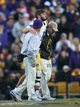 Nov 29, 2013; Baton Rouge, LA, USA; LSU Tigers quarterback Zach Mettenberger (8) is helped off the field after being injured in the fourth quarter against the Arkansas Razorbacks at Tiger Stadium. LSU defeated Arkansas 31-27. Mandatory Credit: Crystal LoGiudice-USA TODAY Sports