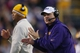 Nov 29, 2013; Baton Rouge, LA, USA; LSU Tigers head coach Les Miles claps after the Tigers kicked a field goal in the fourth quarter against the Arkansas Razorbacks at Tiger Stadium. LSU defeated Arkansas 31-27. Mandatory Credit: Crystal LoGiudice-USA TODAY Sports