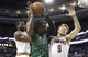 Nov 29, 2013; Boston, MA, USA; Boston Celtics small forward Gerald Wallace (45) grabs a rebound between Cleveland Cavaliers shooting guard Matthew Dellavedova (9) and shooting guard Dion Waiters (3) during the first quarter at TD Garden. Mandatory Credit: Winslow Townson-USA TODAY Sports