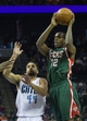 Nov 29, 2013; Charlotte, NC, USA; Milwaukee Bucks power forward Khris Middleton (22) goes up for a shot over Charlotte Bobcats shooting guard Jeff Taylor (44) during the first half at Time Warner Cable Arena. Mandatory Credit: Jeremy Brevard-USA TODAY Sports