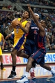 Nov 29, 2013; Auburn Hills, MI, USA; Los Angeles Lakers small forward Nick Young (0) drives to the basket against Detroit Pistons shooting guard Rodney Stuckey (3) during the first quarter at The Palace of Auburn Hills. Mandatory Credit: Tim Fuller-USA TODAY Sports