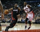 Nov 29, 2013; Toronto, Ontario, CAN; Miami Heat guard Dwyane Wade (3) moves the ball against Toronto Raptors guard Terrence Ross (31) at the Air Canada Centre. Miami defeated Toronto 90-83. Mandatory Credit: John E. Sokolowski-USA TODAY Sports