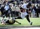 Nov 30, 2013; Nashville, TN, USA; Wake Forest Demon Deacons quarterback Tanner Price (10) scores a touchdown against the Vanderbilt Commodores during the first quarter at Vanderbilt Stadium. Mandatory Credit: Randy Sartin-USA TODAY Sports