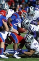 Nov 30, 2013; Lawrence, KS, USA; Kansas Jayhawks running back James Sims (29) fumbles the ball while being tackled by Kansas State Wildcats defensive back Dante Barnett (22) and defensive tackle Valentino Coleman (99) in the first half at Memorial Stadium. Mandatory Credit: John Rieger-USA TODAY Sports