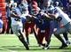 Nov 30, 2013; Lawrence, KS, USA; Kansas State Wildcats running back John Hubert (33) runs with the football against Kansas Jayhawks defensive lineman Jordan Tavai (9) in the first half at Memorial Stadium. Mandatory Credit: John Rieger-USA TODAY Sports