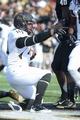 Nov 30, 2013; Nashville, TN, USA; Wake Forest Demon Deacons running back Dominique Gibson (14) scores a touchdown against the Vanderbilt Commodores during the second quarter at Vanderbilt Stadium. Mandatory Credit: Randy Sartin-USA TODAY Sports