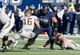Nov 30, 2013; Logan, UT, USA; Wyoming Cowboys quarterback Brett Smith (16) tries to get past Utah State Aggies center Tyler Larsen (58) during the first quarter at Romney Stadium. Mandatory Credit: Chris Nicoll-USA TODAY Sports