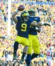 Nov 30, 2013; Ann Arbor, MI, USA; Michigan Wolverines wide receiver Drew Dileo (9) celebrates with tight end Devin Funchess (87) after catching a pass for a touchdown during the fourth quarter against the Ohio State Buckeyes at Michigan Stadium. Mandatory Credit: Andrew Weber-USA TODAY Sports