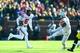 Nov 30, 2013; Ann Arbor, MI, USA; Ohio State Buckeyes quarterback Braxton Miller (5) runs the ball during the third quarter against the Michigan Wolverines at Michigan Stadium. Mandatory Credit: Andrew Weber-USA TODAY Sports