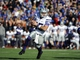 Nov 30, 2013; Lawrence, KS, USA; Kansas State Wildcats quarterback Jake Waters (15) rushes for a touchdown against the Kansas Jayhawks in the second half at Memorial Stadium. Kansas State won the game 31-10. Mandatory Credit: John Rieger-USA TODAY Sports