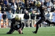 Nov 30, 2013; Nashville, TN, USA; Vanderbilt Commodores kicker Carey Spear (39) kicks the game winning field goal against the Wake Forest Demon Deacons with 39 seconds left in the game at Vanderbilt Stadium. Vanderbilt won 23 to 21. Mandatory Credit: Randy Sartin-USA TODAY Sports