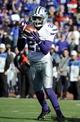 Nov 30, 2013; Lawrence, KS, USA; Kansas State Wildcats defensive back Dante Barnett (22) intercepts a pass against the Kansas Jayhawks in the second half at Memorial Stadium. Kansas State won the game 31-10. Mandatory Credit: John Rieger-USA TODAY Sports