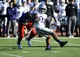 Nov 30, 2013; Lawrence, KS, USA; Kansas State Wildcats running back John Hubert (33) is tackled by Kansas Jayhawks linebacker Michael Reynolds (55) in the second half at Memorial Stadium. Kansas State won the game 31-10. Mandatory Credit: John Rieger-USA TODAY Sports