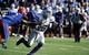 Nov 30, 2013; Lawrence, KS, USA; Kansas State Wildcats quarterback Jake Waters (15) tosses the ball under pressure from Kansas Jayhawks linebacker Darius Willis (52) in the second half at Memorial Stadium. Kansas State won the game 31-10. Mandatory Credit: John Rieger-USA TODAY Sports