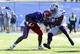 Nov 30, 2013; Lawrence, KS, USA; Kansas Jayhawks running back James Sims (29) is tackled by Kansas State Wildcats linebacker Tre Walker (50) in the second half at Memorial Stadium. Kansas State won the game 31-10. Mandatory Credit: John Rieger-USA TODAY Sports