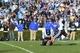 Nov 30, 2013; Chapel Hill, NC, USA;  Duke Blue Devils kicker Ross Martin (35) kicks the game winning field goal as punter Will Monday (41) holds in the fourth quarter. The Duke Blue Devils defeated the North Carolina Tar Heels 27-25 at Kenan Memorial Stadium. Mandatory Credit: Bob Donnan-USA TODAY Sports