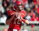 Nov 30, 2013; Salt Lake City, UT, USA; Utah Utes quarterback Adam Schulz (12) drops back to pass during the first half against the Colorado Buffaloes at Rice-Eccles Stadium. Mandatory Credit: Russ Isabella-USA TODAY Sports