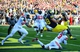 Nov 30, 2013; Ann Arbor, MI, USA; Michigan Wolverines tight end Jake Butt (88) catches a pass in the end zone for a touchdown during the fourth quarter against the Ohio State Buckeyes at Michigan Stadium. Mandatory Credit: Andrew Weber-USA TODAY Sports
