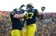 Nov 30, 2013; Ann Arbor, MI, USA; Michigan Wolverines tight end Devin Funchess (87) celebrates with offensive linesman Kyle Kalis (67) after catching a pass in the touchdown during the fourth quarter against the Ohio State Buckeyes at Michigan Stadium. Mandatory Credit: Andrew Weber-USA TODAY Sports