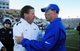 Nov 30, 2013; Fort Collins, CO, USA; Colorado State Rams head coach Jim McElwain (left) greets Air Force Falcons head coach Troy Calhoun (right) following the game at Hughes Stadium. The Rams defeated the Falcons 58-13. Mandatory Credit: Ron Chenoy-USA TODAY Sports