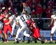 Nov 30, 2013; Salt Lake City, UT, USA; Colorado Buffaloes quarterback Sefo Liufau (13) gets off a pass as he is hit by Utah Utes defensive tackle Viliseni Fauonuku (98) during the second half at Rice-Eccles Stadium. Utah won 24-17. Mandatory Credit: Russ Isabella-USA TODAY Sports