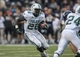 Nov 30, 2013; Houston, TX, USA; Tulane Green Wave running back Orleans Darkwa (26) rushes during the fourth quarter against the Rice Owls at Rice Stadium. Mandatory Credit: Troy Taormina-USA TODAY Sports